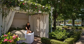 A woman getting a massage outdoors at Silverado Resort and Spa