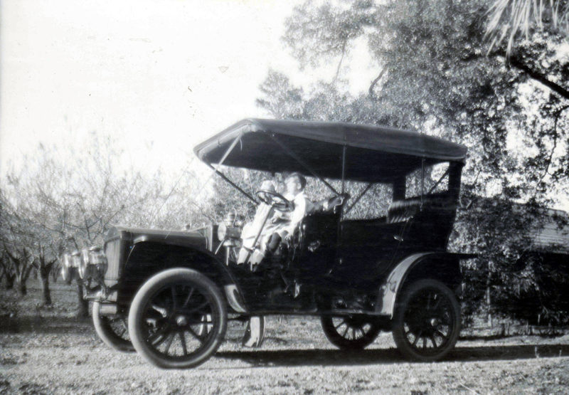 black and white photo of an old car